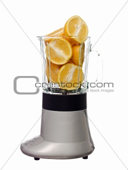 Blender with oranges