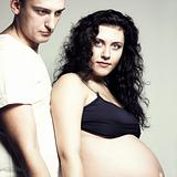 happy pregnant woman with husband