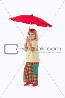 boy with long blond hair playing with a red umbrella