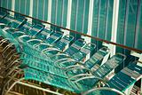 Several Cruise Ship Lounge Chairs Abstract Image.