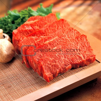 Fresh raw beef on kitchen table