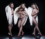 Three beautiful angels on black background