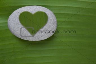 Green Heart on Pebble