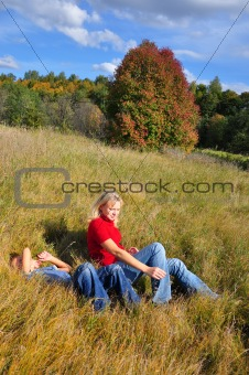 Young boy and ma lying outdoors
