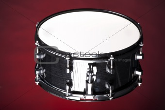 Black Snare Drum Isolated On Red