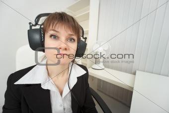 Ridiculous woman dressed on head big ear-phones