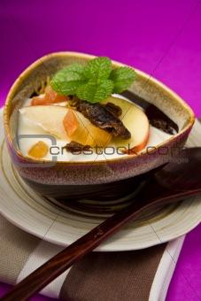 cereal, dried fruit, apple in yogurt