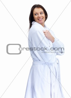 Pretty mature female in a bathrobe smiling over white