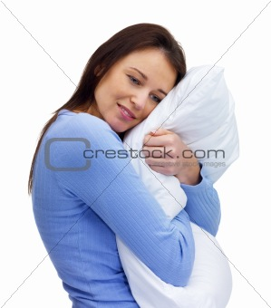 Relaxed woman with a pillow on white