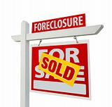 Sold Foreclosure Home For Sale Real Estate Sign Isolated on a White Background.