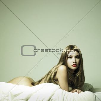 Young sensual woman in bed