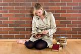 women in a trenchcoat reads book