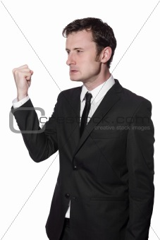 angry businessman is showing his fist