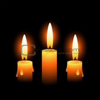 Three vector candles on a black background