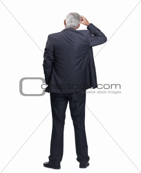 Rear view of a business man thinking over white