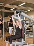 Girl using an exercise machine 