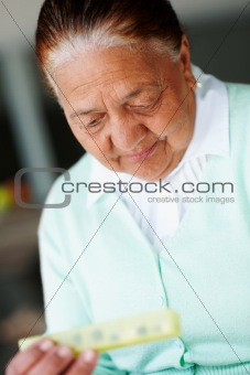 Senior woman with her medicine box