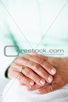 Closeup focus of a senior woman's hand together