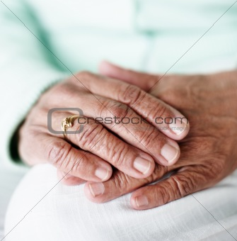 Closeup focus of an elderly woman's hand together