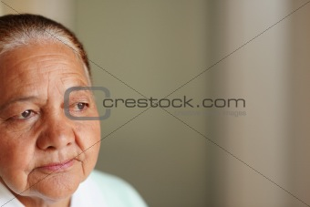Closeup cut image of an old woman looking away