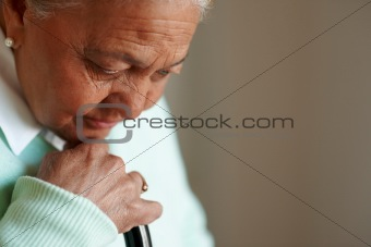 Worried elderly woman , thinking