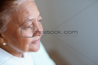 Tension elderly woman looking away , thoughtful