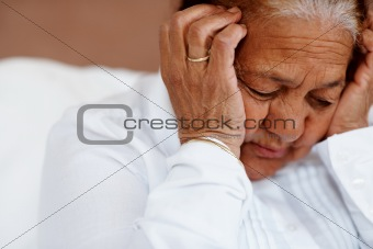 Closeup of a senior woman having a headache