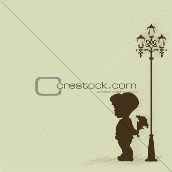 Boy with a bouquet of standing under a street lamp