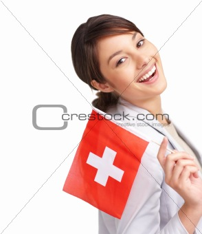 Beautiful young female with Switzerland's flag against white