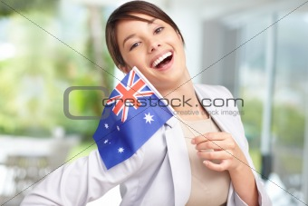 Pretty young woman with Australia's flag