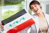 Lovely young woman displaying an Iraqi flag