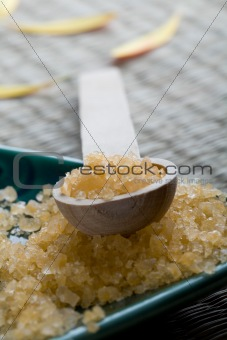 Bath salts in spoon and dish.