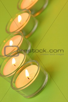 Five tea lights, green