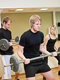 Group of people lifting weights
