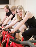 Group of people having spinning class