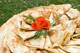 Pancakes decorated with tomato rose