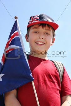 Smiling boy with flag