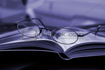 Close up on the Glasses and the Magazine