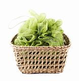 Green bath loofah in a basket