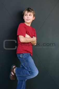 Boy leaning against wall