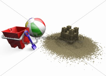 Sandcastle with beach ball, bucket and spade