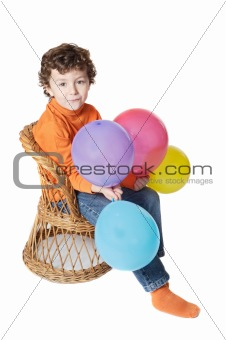 adorable boy with balloons