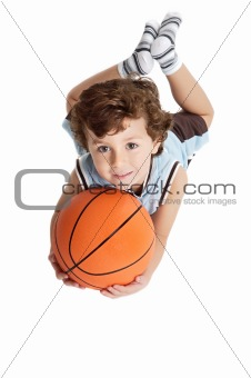adorable boy playing the basketball