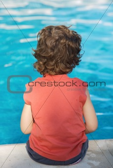 adorable boy watching water