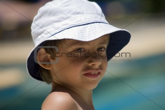 portrait of the boy beside swimming pool