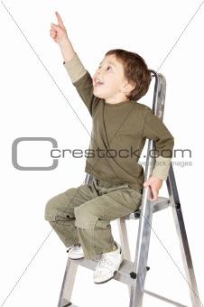 adorable boy ndicating the sky