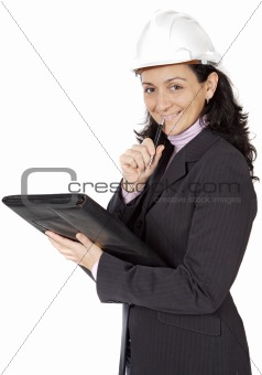 attractive young person architect taking notes in a folder