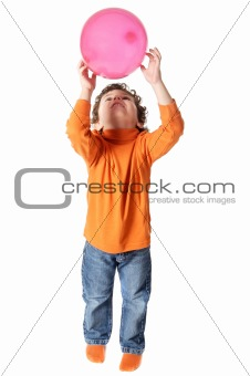 adorable boy playing with balloon