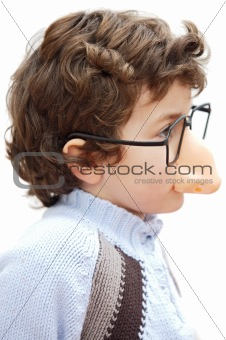 adorable boy with glasses and nose of toy
