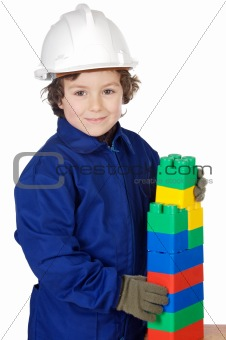 adorable future builder constructing a brick wall with toy piece